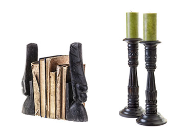New Uses home accessories: two black bookends with face profiles and two black candlesticks with small green candles against white background