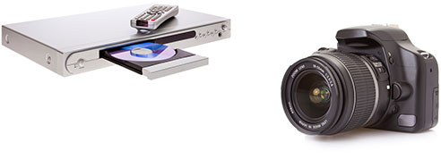 New Uses electronics: silver DVD player with DVD in tray and remote control on top, large digital camera with nice lens