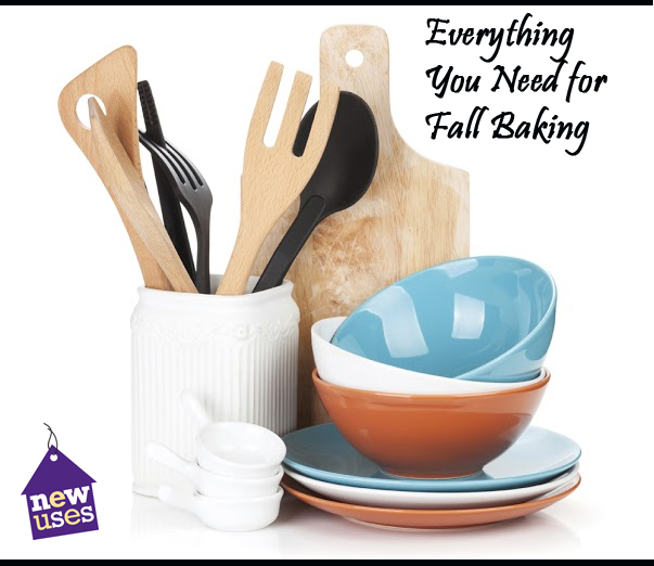 still life setup of kitchen items: cooking utensils, plates and bowls, measuring cups and a cutting board